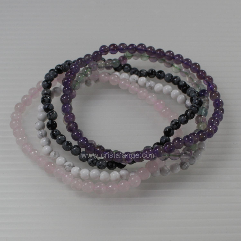 Plusieurs bracelets avec des pierre blanche, pierre rose, pierre noire et  pierre violette pour